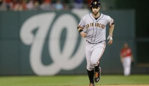 Brandon Belt trots around the bases after hitting a solo home run in the 18th inning of the Giants 2-1 win in Saturday's NLDS game 2.