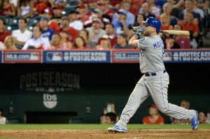 Mike Moustakas hits a home run in the 11th inning of Game 1 of the ALDS in Anaheim, Calif. The Royals won 3-2.
