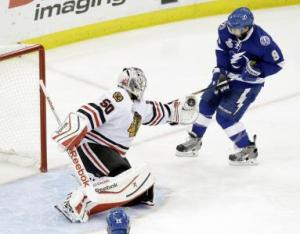 Corey Crawford makes a glove save in Game 5 of the Stanley Cup Finals on Saturday.