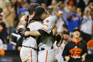 Buster Posey (left),hugs Chris Heston following his no-hitter as the Giants win 5-0 Tuesday in New York.