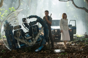 Owen Grady (Pratt) and Claire Dearing (Howard) inspect damage to the Gyrosphere by the Indominus Rex in Jurassic World.