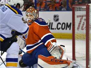 Goaltender Cam Talbot (33),makes a toe save on the Blues in Edmonton's 4-2 loss on Thursday.