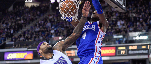 Nerlens Noel of Philadelphia dunks over Kings center DeMarcus Cousins on Wednesday night.